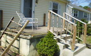 demolished porch and railing